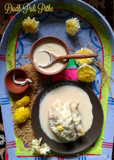 Dudh puli pithe / rice dumplings stuffed with sweetened coconut - Sankranti special